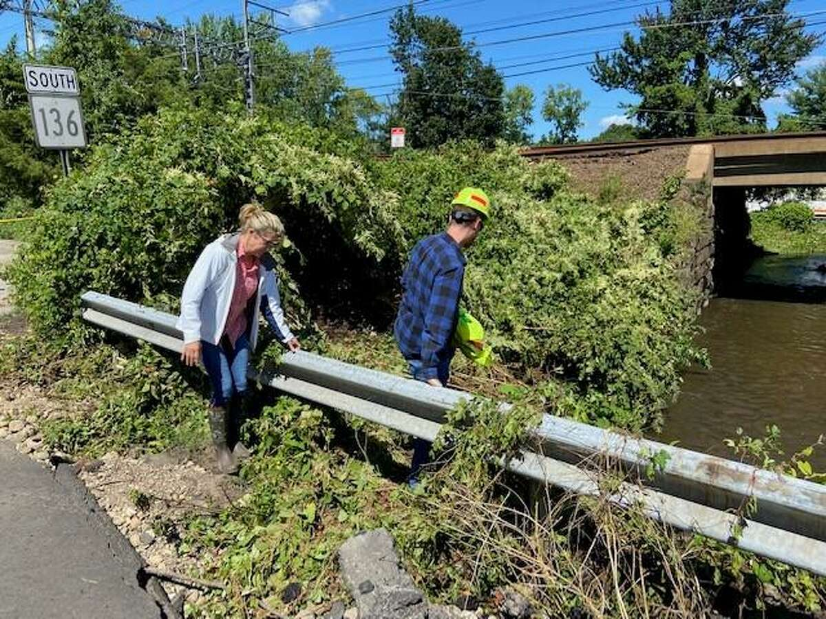 First selectman candidate and current Board of Selectmen member, Monica McNally surveys the damage with CT Department of Transportation and Dept. of Pubic Works employees.