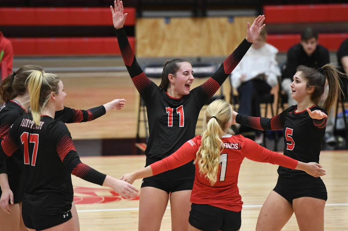 Nicole Adams, center, a Shenendehowa graduate, celebrates during a match for St. Francis (Pa.).