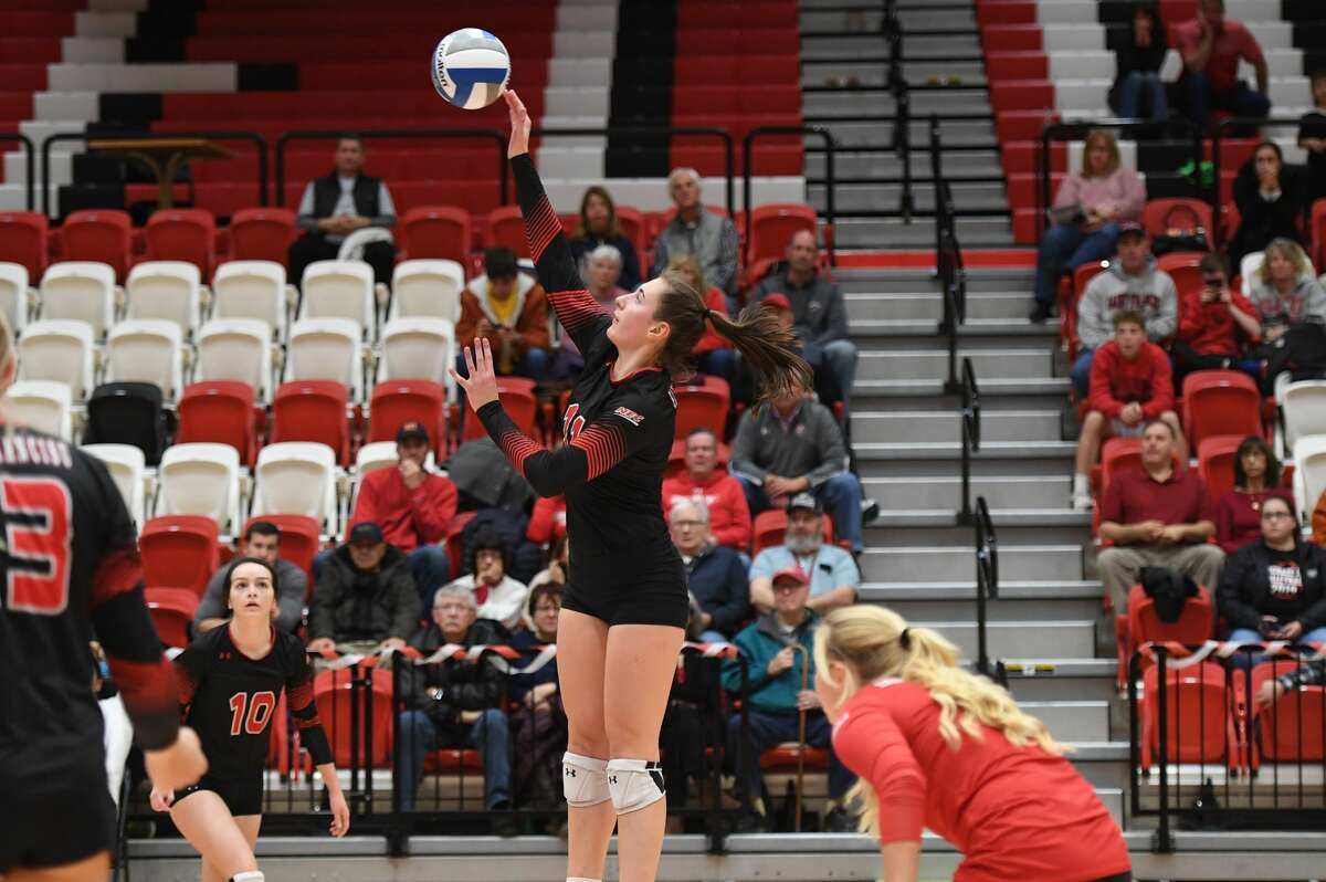 St. Francis' Nicole Adams goes up for a kill in a recent match. Adams is a Shenendehowa graduate.
