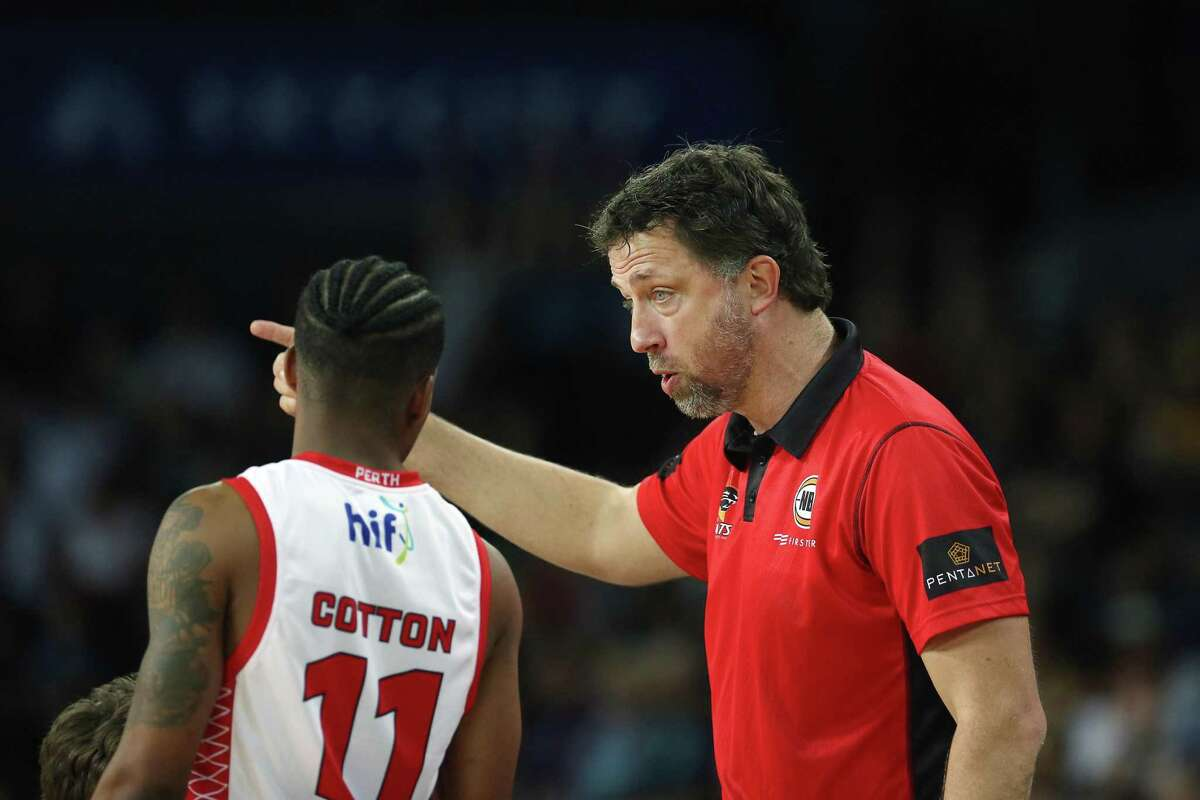 Assistant Coach Matthew Nielsen of the Wildcats talks to Bryce Cotton during the round 12 NBL match between the New Zealand Breakers and the Perth Wildcats at Spark Arena on January 06, 2019 in Auckland, New Zealand.