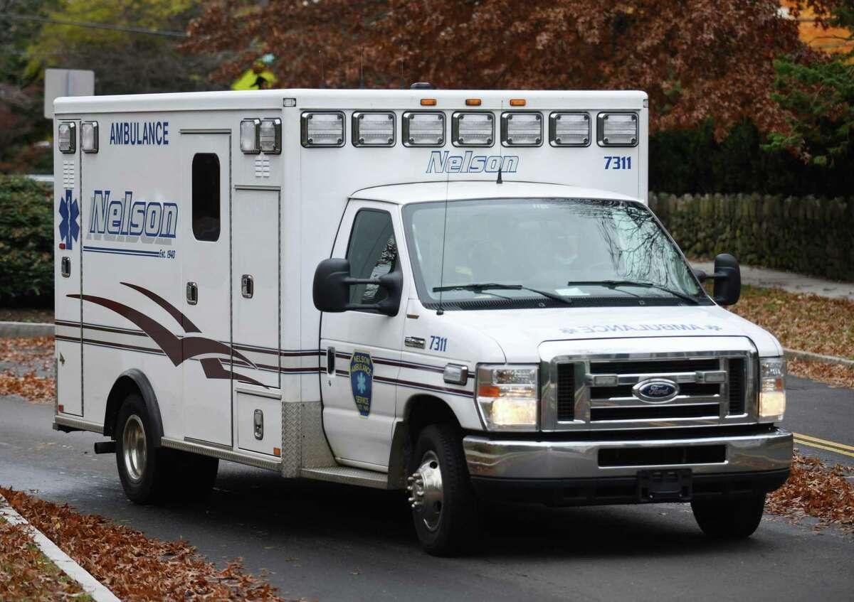 An ambulance drives by Greenwich Hospital in Greenwich, Conn. Thursday, Nov. 12, 2020.