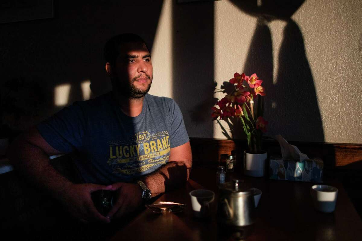 Ahmad Rashad, an Afghan-American and former translator in Afghanistan for U.S. soldiers at the Afghan Village Restaurant, Tuesday, Sept. 7, 2021, in Houston. Rashad was about 10 years old when a series of terrorist attacks took place in U.S. soil on Sept. 11, 2001.