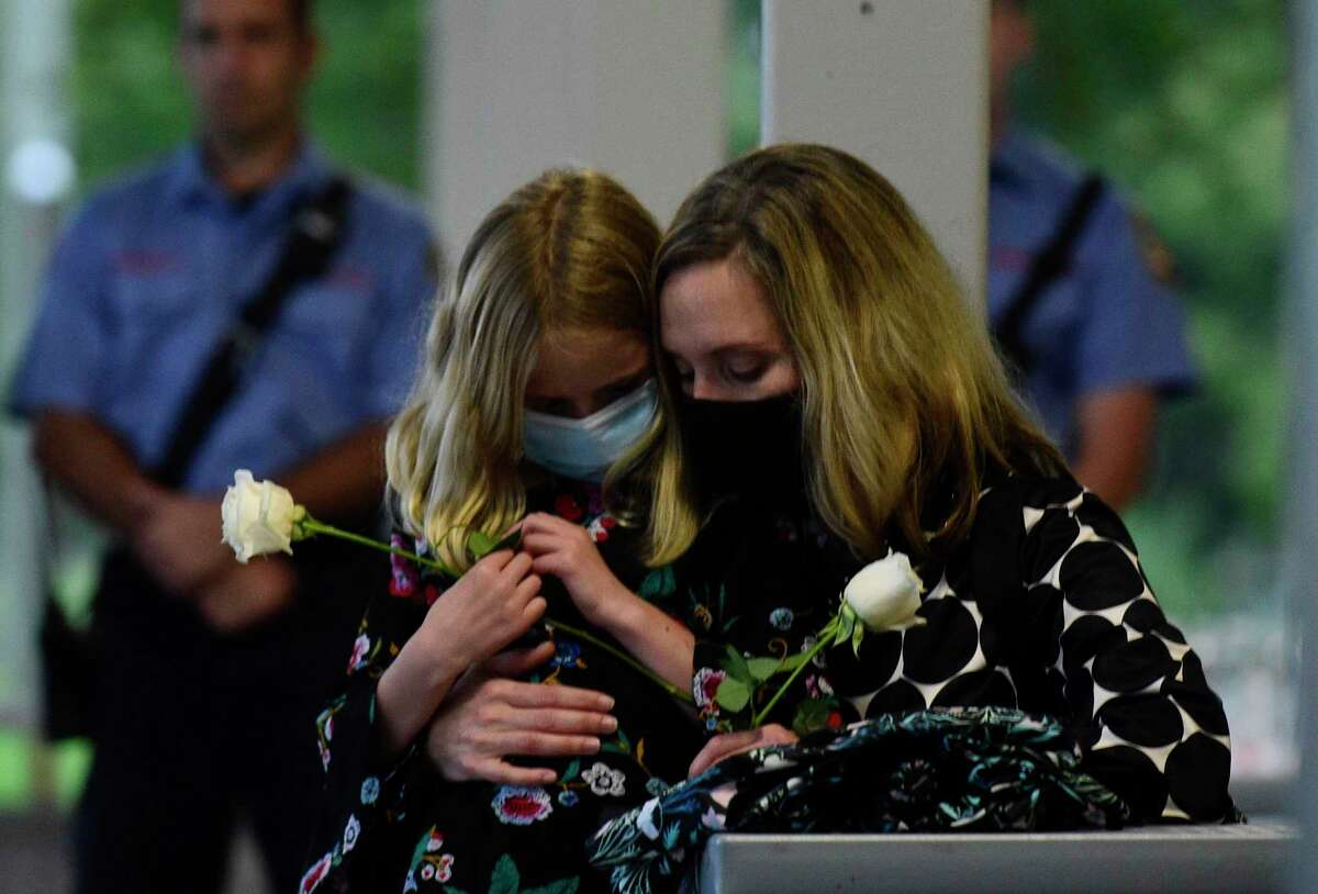 Sara Coffey and her daughter mourn David Winton during a moment of silence as Gov. Ned Lamont and Lt. Governor Susan Bysiewicz lead the State of Connecticut's annual 9/11 memorial ceremony.