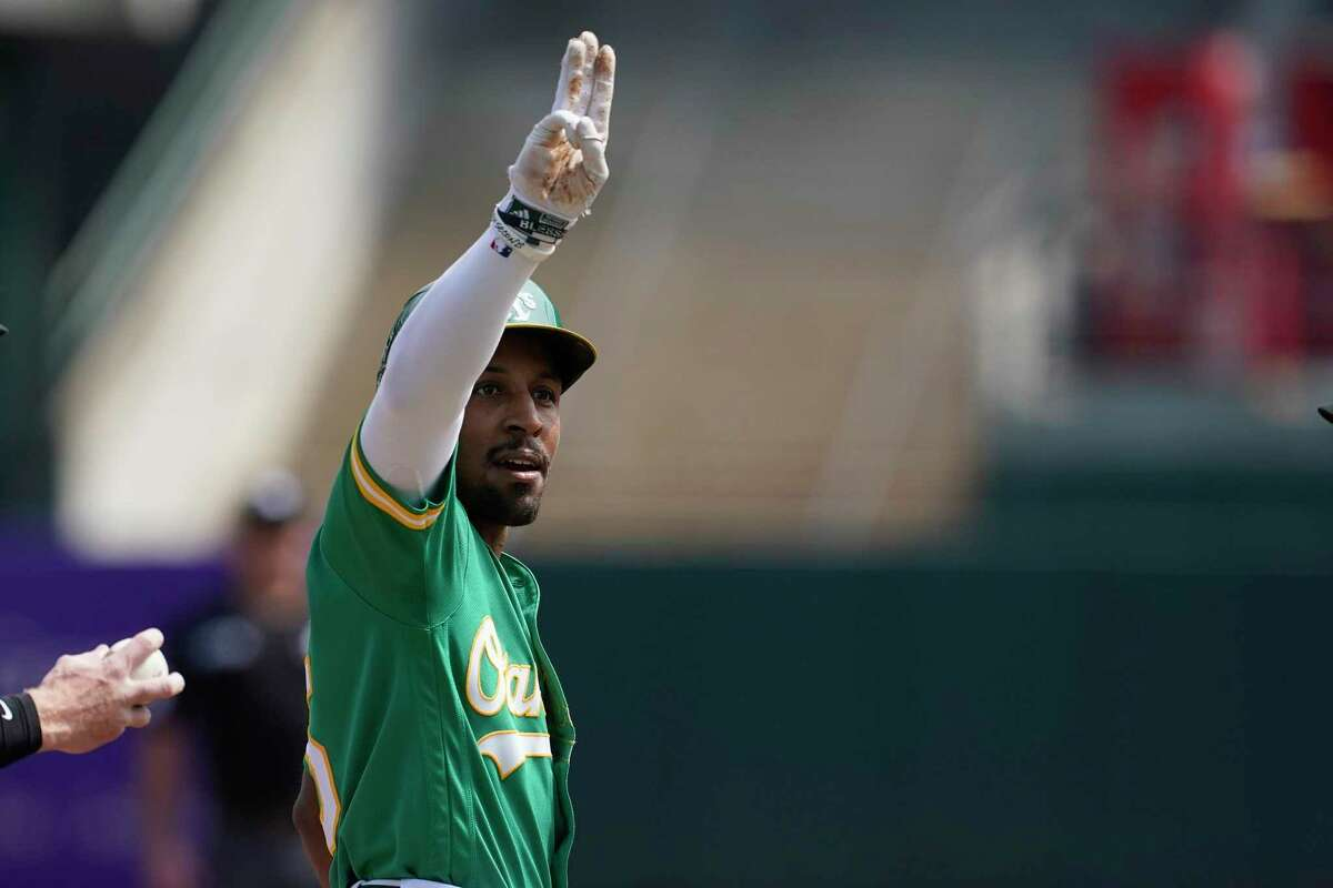 Oakland Athletics' Tony Kemp gestures after hitting an RBI-triple against the Chicago White Sox during the second inning of a baseball game in Oakland, Calif., Thursday, Sept. 9, 2021. (AP Photo/Jeff Chiu)