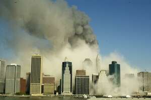 A view of the Manhattan skyline from Brooklyn, Tuesday, Sept. 11, 2001, after the World Trade Center towers collapsed following being struck by airplanes.