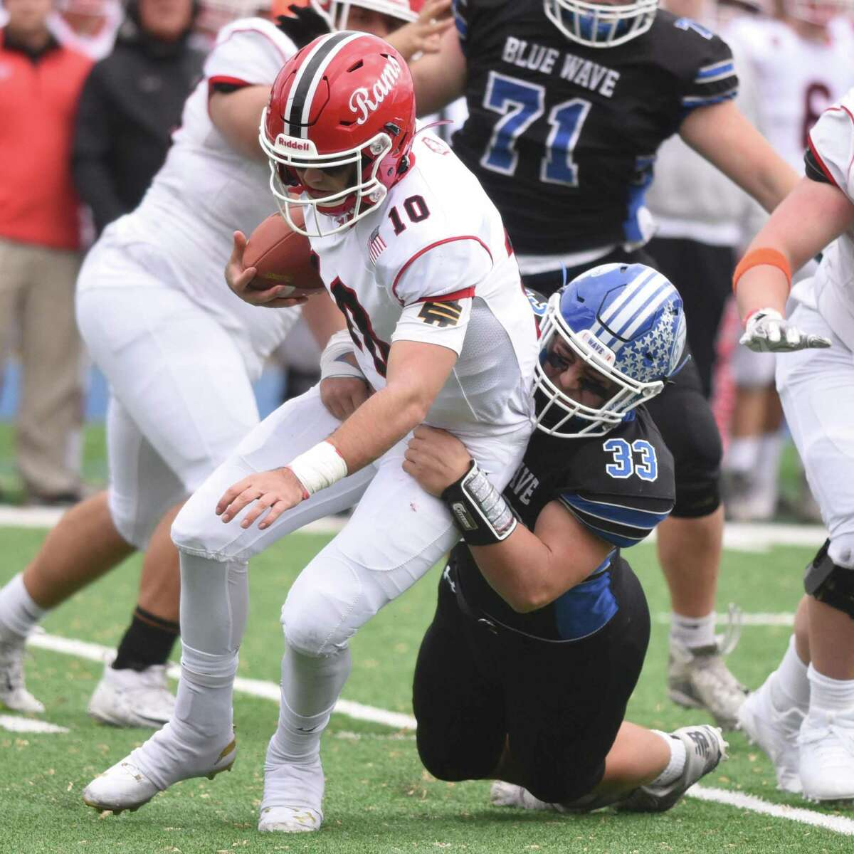 Darien's David Evanchick (33) catches New Canaan quarterback Drew Pyne (10) during the annual Turkey Bowl football game between Darien and New Canaan at Darien High School on Thursday, Nov. 28, 2019.
