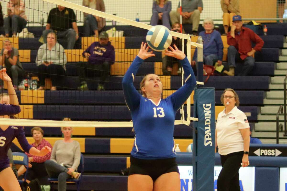 Carly Bennett sets up Onekama's dominant hitting attack with one of her 18 assists. (Robert Myers/News Advocate)