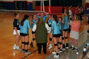 Brethren varsity volleyball celebrates a win over Manistee Catholic Central on Thursday night. (McLain Moberg/News Advocate)