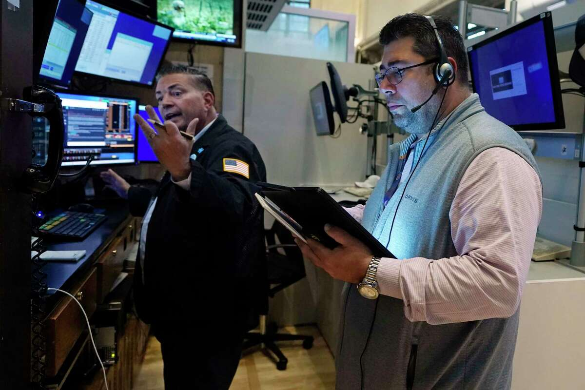 """Traders work on the floor of the New York Stock Exchange on Thursday, Sept. 9, 2021. Xerox announced Thursday it would end its 60-year run on the exchange, with plans to move its """"XRX"""" ticker to the Nasdaq on Sept. 21. (AP Photo/Richard Drew)"""