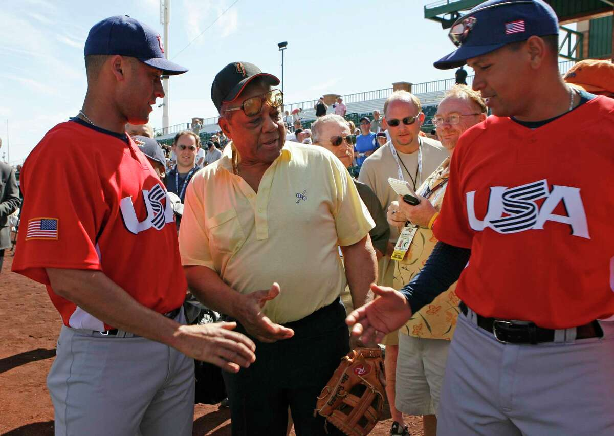 giants_238_df.jpg Derek Jeter (left) and Alex Rodriguez (right) met baseball legend Willie Mays for the first time before the game. The two players seemed so happy to finally meet him that they both tried to shake his hand at once. Team USA of the Baseball Classic played an exhibition game today against the San Francisco Giants at Scottsdale Stadium. Event was shot on 3/5/06 in Scottsdale. San Francisco Chronicle photo by Deanne Fitzmaurice
