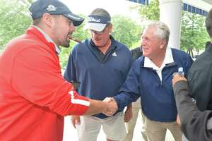 Norwalk Mayor Harry Rilling shakes hands with Jonathan Riddle at the 2018 Mayor's Golf Tournament at Oak Hills Park in Norwalk, Conn. Riddle is the 2021 Republican candidate seeking to unseat Rilling on Election Day.