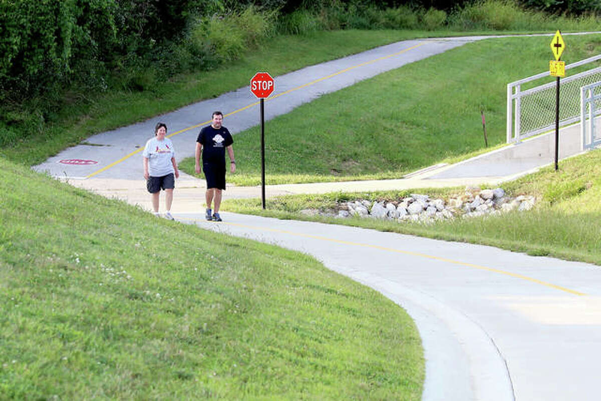 Couple Nida and Steven Graham enjoy a 990-foot stretch of trail between Center Grove and Madison County Transit's Nature Trail on the west side of Route 157. Completed last year, the trail section is Phase 1 of four for a larger project in Edwardsville.