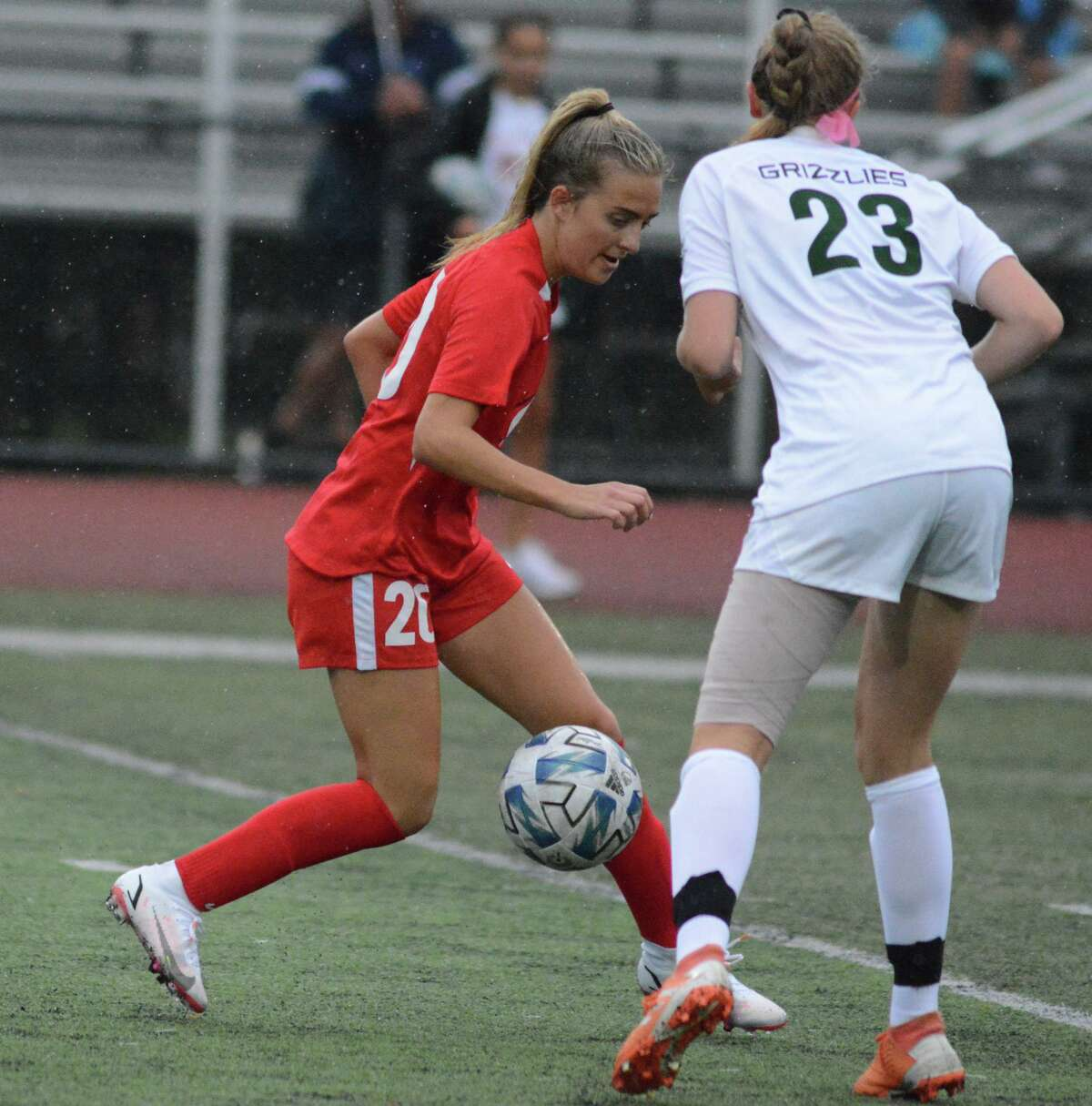 Ariana Geloso of Cheshire controls the ball as she goes past Abby Moore of Guilford on Thursday.