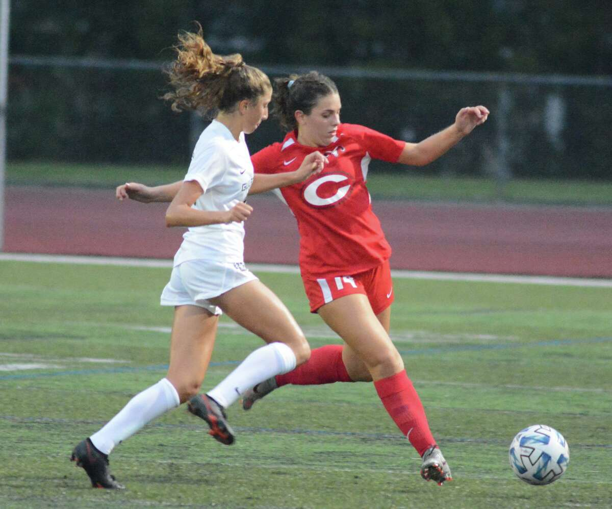 Dani Petronio of Cheshire takes the ball downfield against Guilford on Thursday.
