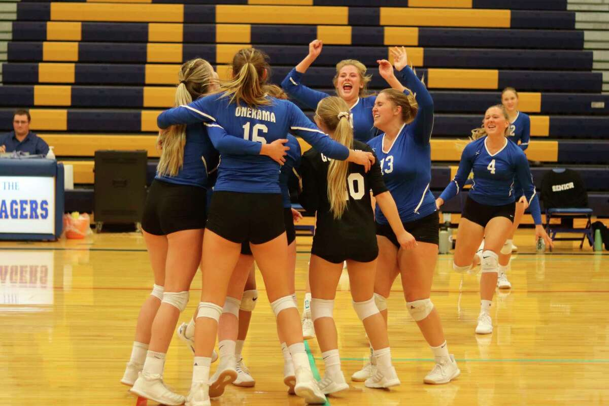 Onekama's players celebrate their win on the court after defeating Leland on Sept. 9. (Robert Myers/News Advocate)