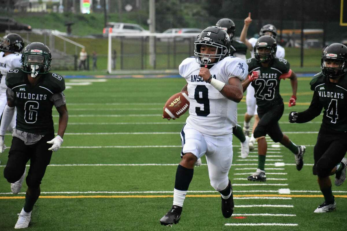 Ansonia's Darell McKnight rushes for a touchdown during a football game against Wilby at Municipal Stadium, Waterbury on Thursday, Sept. 9, 2021.