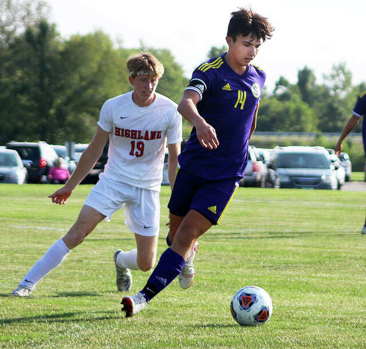 CM's Brayden Zyung (14) controls the ball while being marked by Highland's Owen Morris Thursday in a Mississippi Valley conference game at the Bethalto Sports complex. Zyung scored a goal in CM's 3-0 victory.