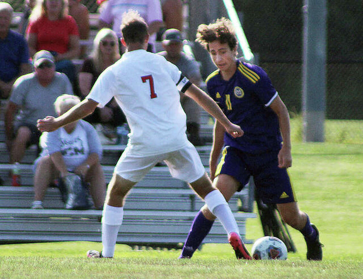 Parker Scottberg of CM (11) and Highland's Alex Roach vye for the ball Thursday at the Bethalto Sports Complex. Scottberg scored a goal in his team's 3-0 win.