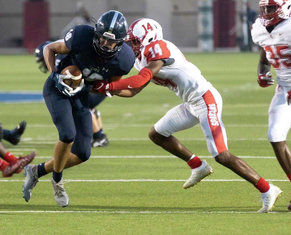 College Park wide receiver Alex Brigman (16) is tackled down by Cypress Lakes Sidney Weakly (14) during the second quarter of a non-district football game at Woodforest Bank Stadium, Thursday, Sept. 9, 2021 in Shenandoah.
