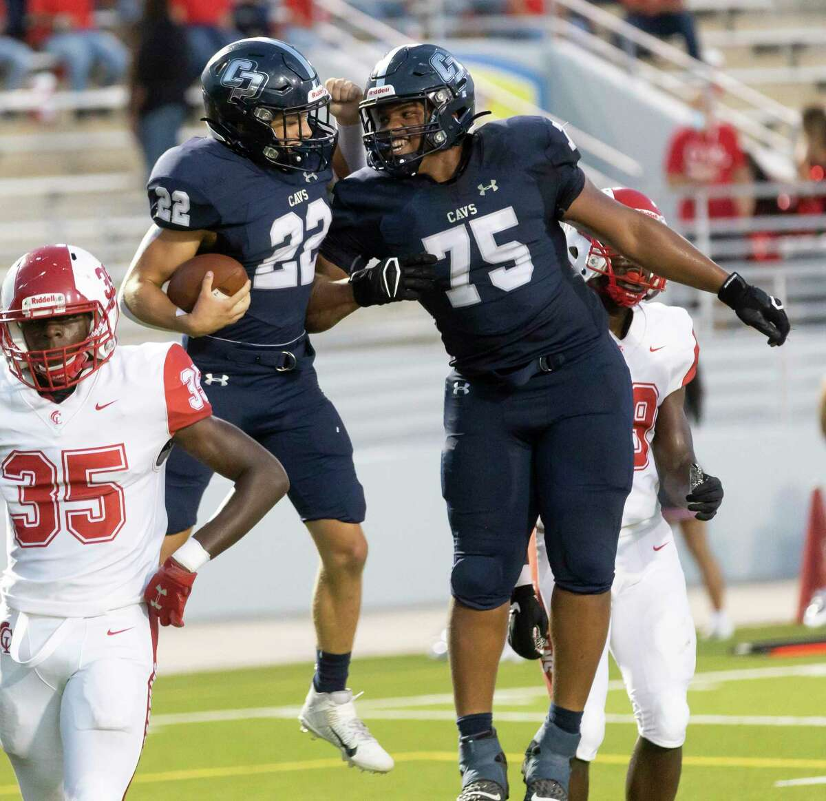 College Park running back Voss Hudson (22) celebrates with offensive lineman Kelan Williams (75) after he scores a touchdown during the second quarter of a non-district football game at Woodforest Bank Stadium, Thursday, Sept. 9, 2021 in Shenandoah.