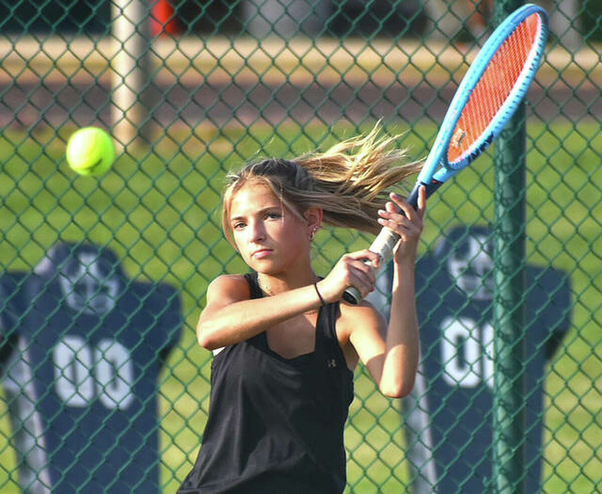 Edwardsville's Ella Reed smashes a return shot during her No. 6 singles match against the O'Fallon Panthers on Thursday in O'Fallon.