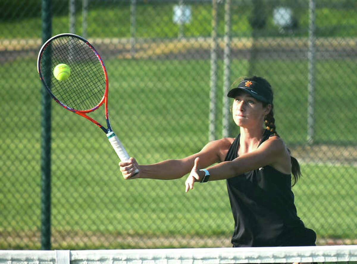 Edwardsville's Sophie Byron plays a shot from near the net during her No. 5 singles match against the O'Fallon Panthers on Thursday in O'Fallon.