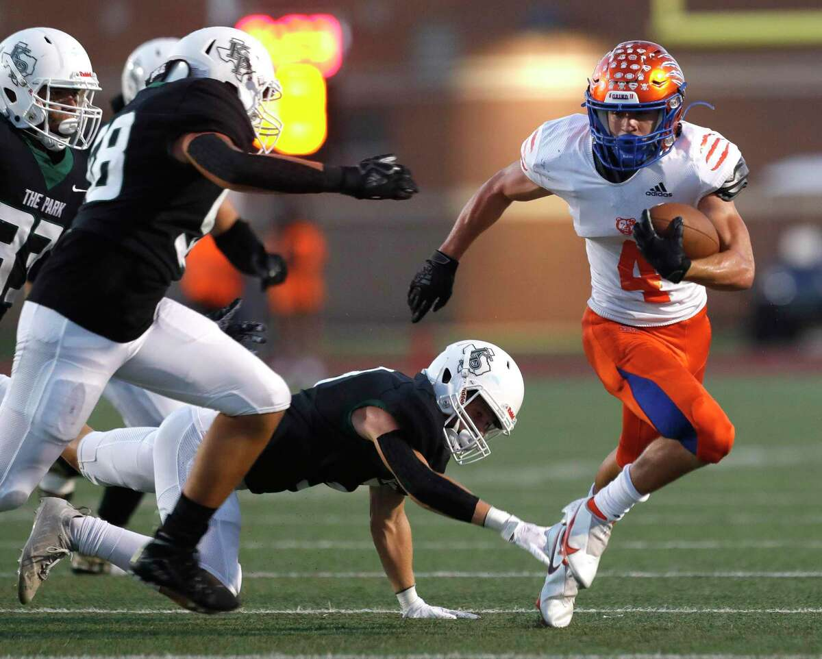 Grand Oaks running back Sean Zver (4) runs for a first down during the second quarter of a non-district high school football game at Turner Stadium, Thursday, Sept. 9, 2021, in Humble.