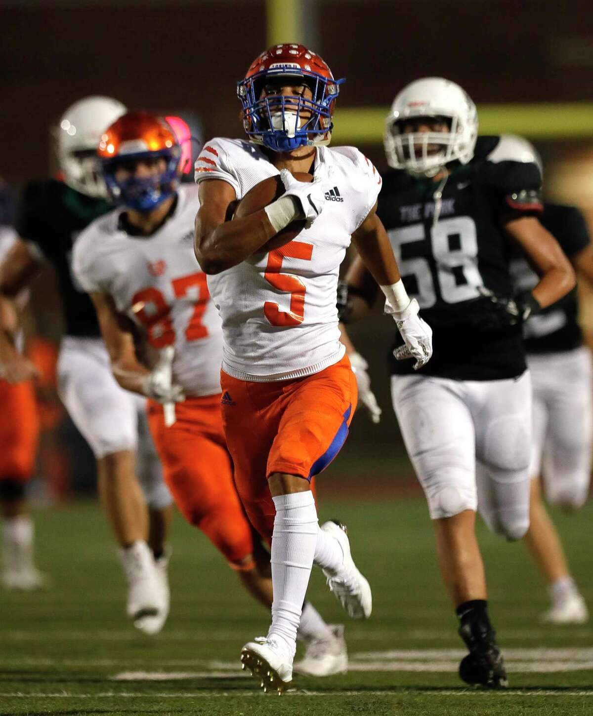 Grand Oaks wide receiver Quanell Farrakhan, Jr. (5) runs for a 54-yard touchdown during the second quarter of a non-district high school football game at Turner Stadium, Thursday, Sept. 9, 2021, in Humble.