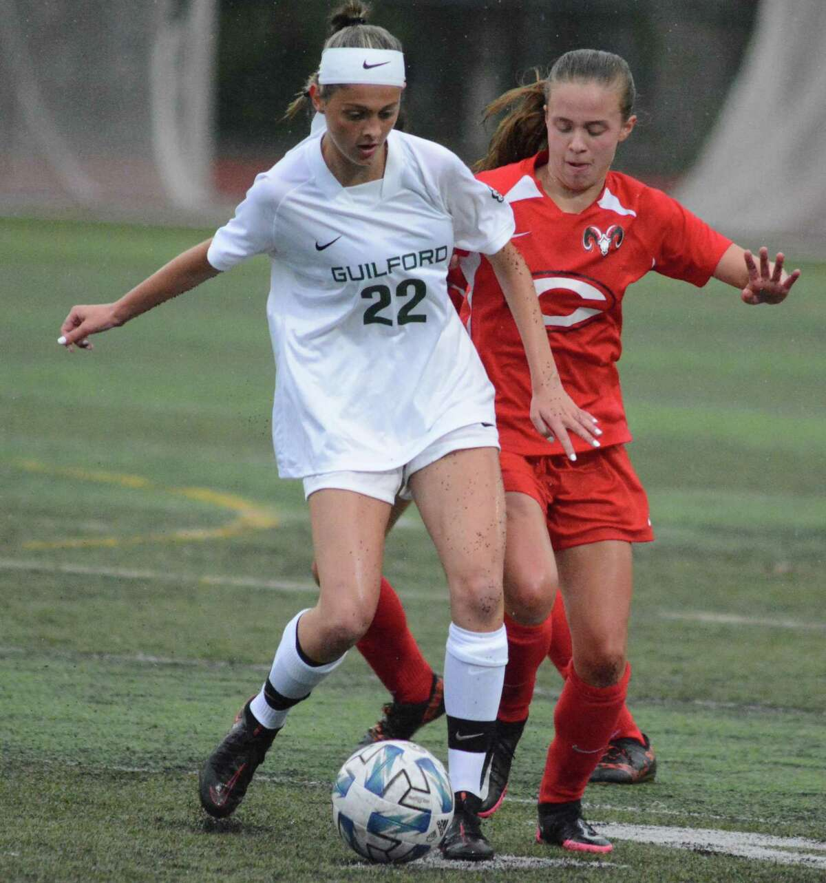 Guilford's Abby Sansone and Cheshire's Helene Lopez fight for the ball on Thursday.