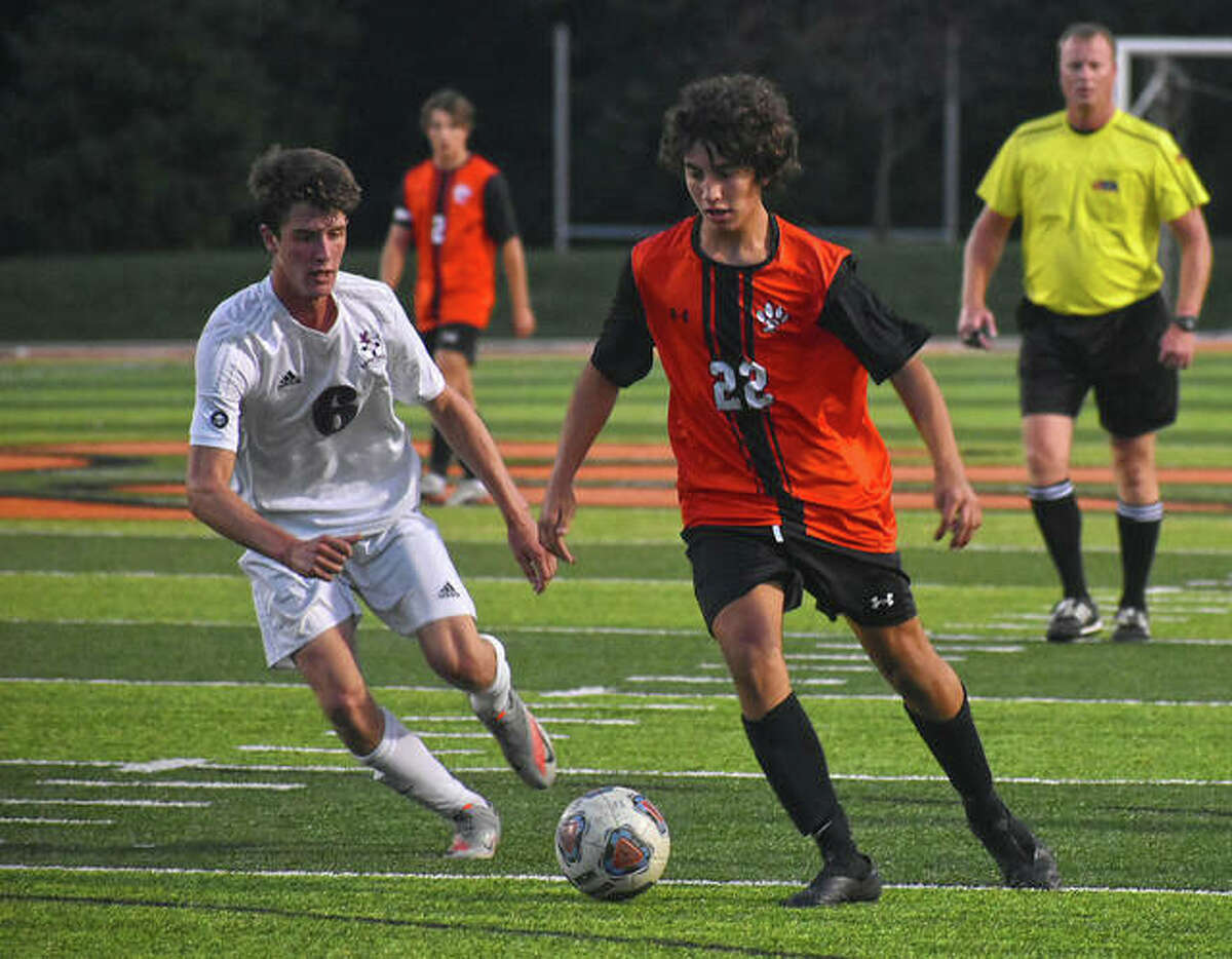 Edwardsville's Abe Gianaris, right, works his way into the 18-yard box during the half of Thursday's game against Gibault inside the District 7 Sports Complex.