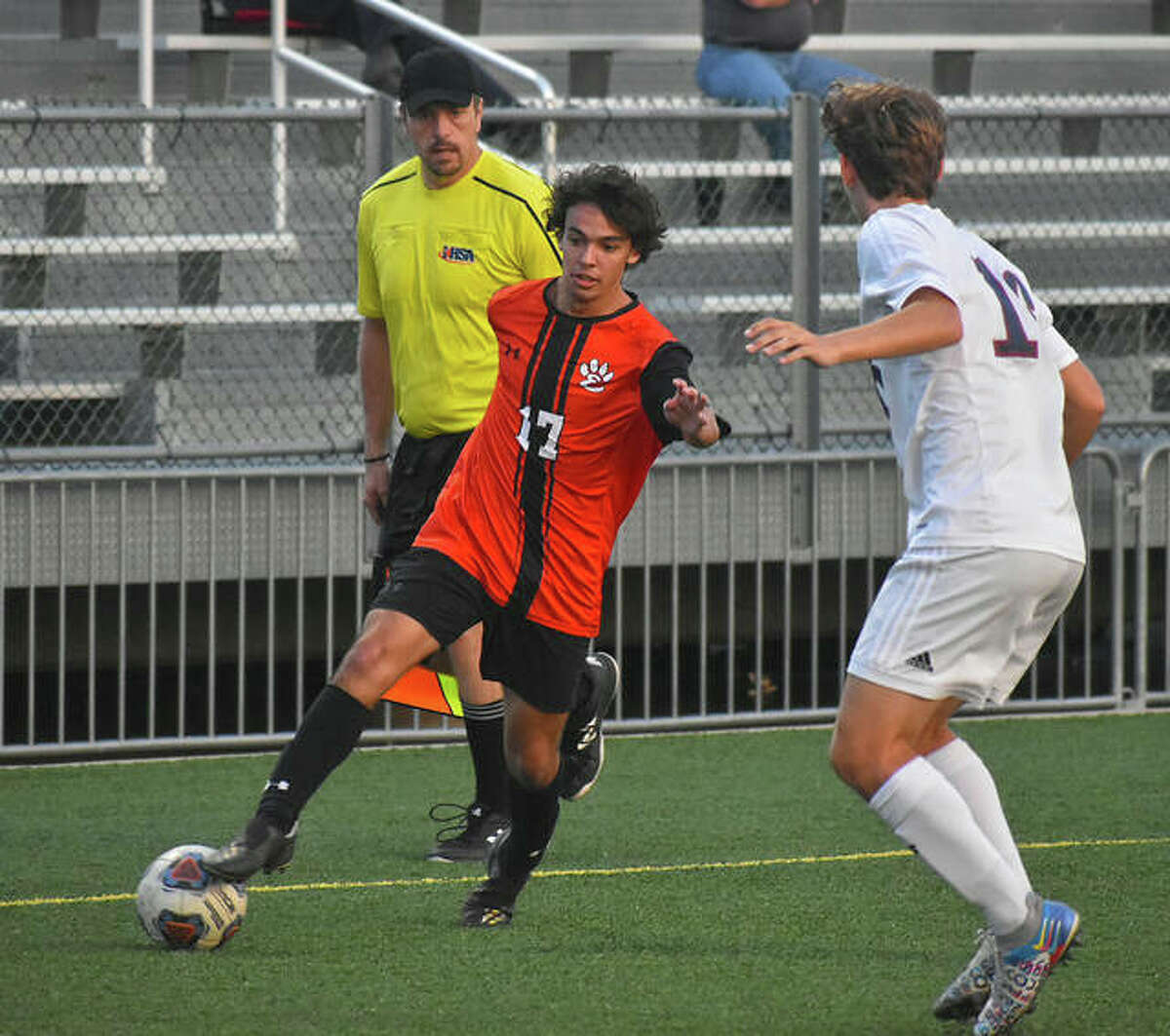 Edwardsville's Wyatt Erber, left, crosses a pass into the 18-yard box during the half of Thursday's game against Gibault inside the District 7 Sports Complex.