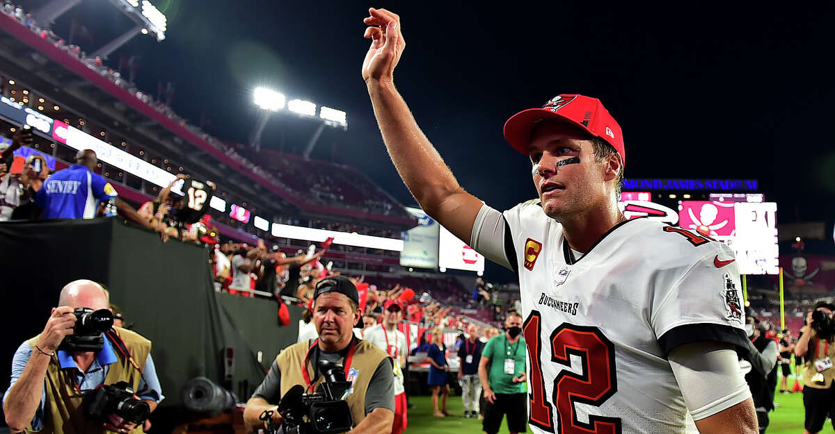 Tom Brady #12 of the Tampa Bay Buccaneers waves to fans after defeating the Dallas Cowboys 31-29 at Raymond James Stadium on September 09, 2021 in Tampa, Florida. (Photo by Julio Aguilar/Getty Images)