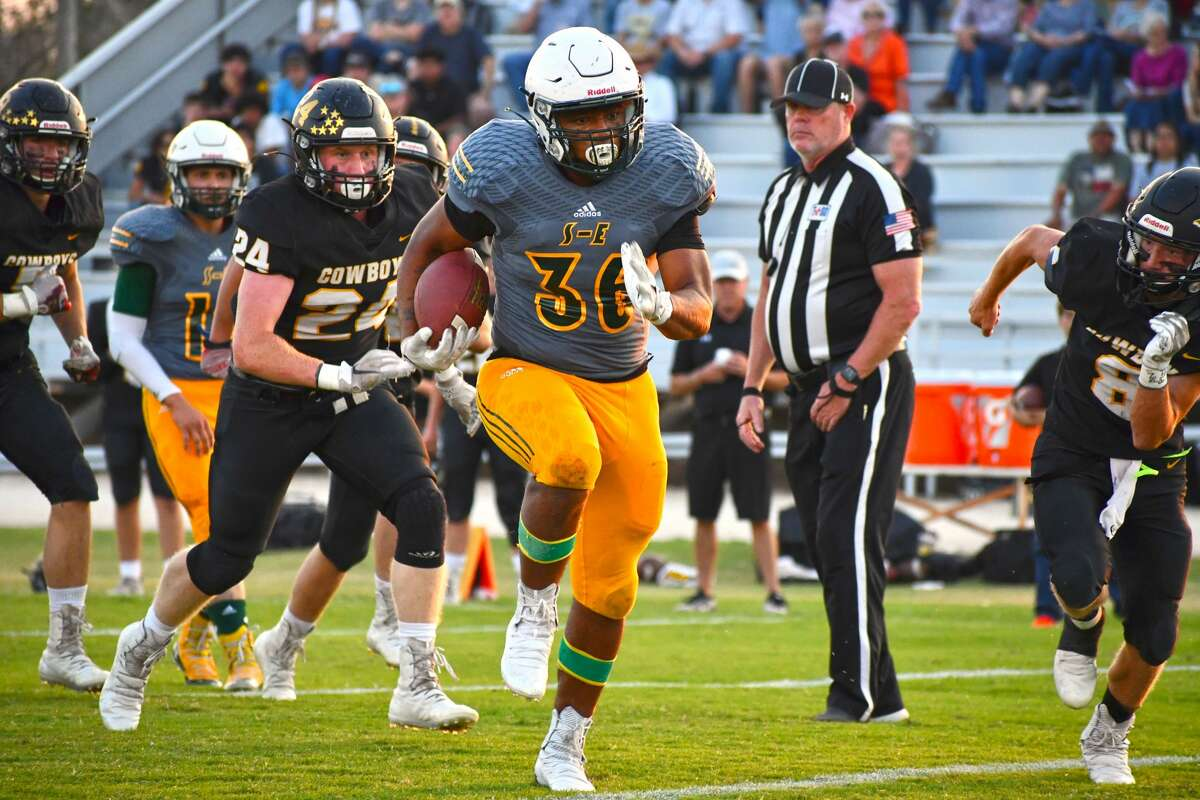 Springlake-Earth's Keshan Holmes races past the Happy defense during their non-district football game on Thursday at the Cowboy Corral at Happy.