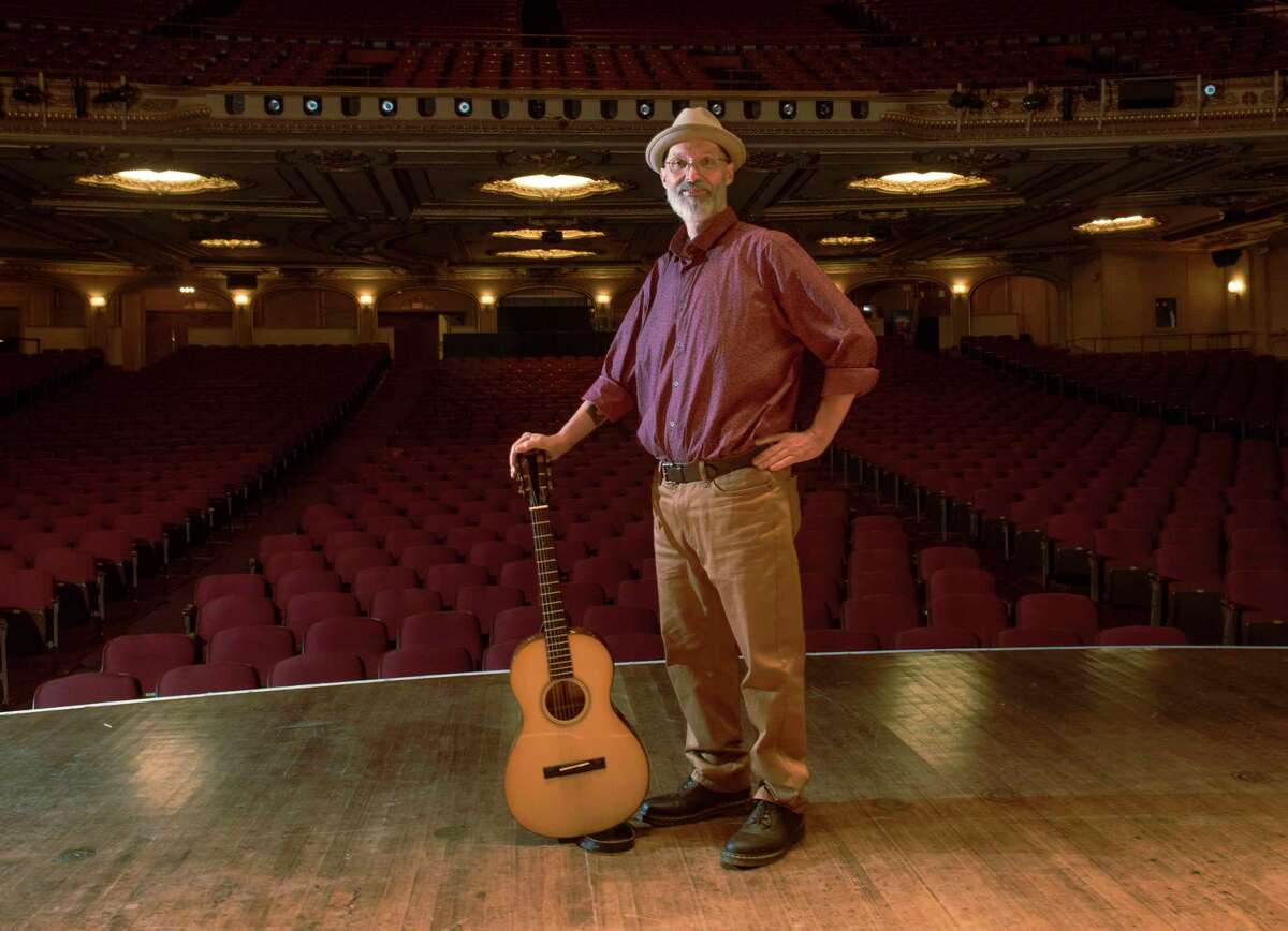 Longtime area musician, writer and artist Michael Eck stands on the stage in the Palace Theatre on Tuesday, Sept. 7, 2021 in Albany, N.Y. Eck, who 20 years ago weighed 450 pounds, now weights 185.