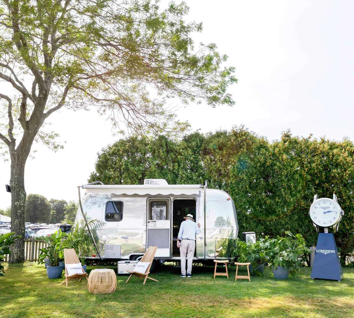 A vintage Airstream trailer is filled with Watches of Switzerland's display in the Hamptons in New York.