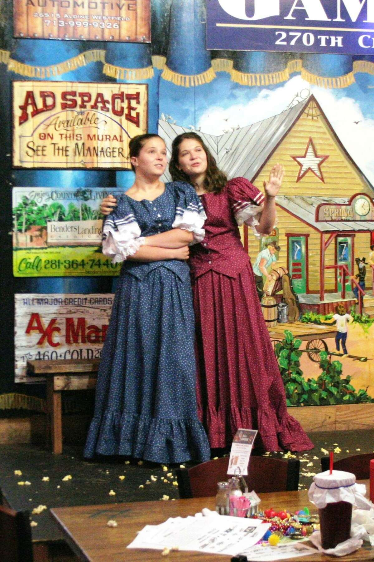 """Actors perform on stage at Puffabelly's in Old Town Spring during Old West Melodrama's production of """"Alaska."""""""