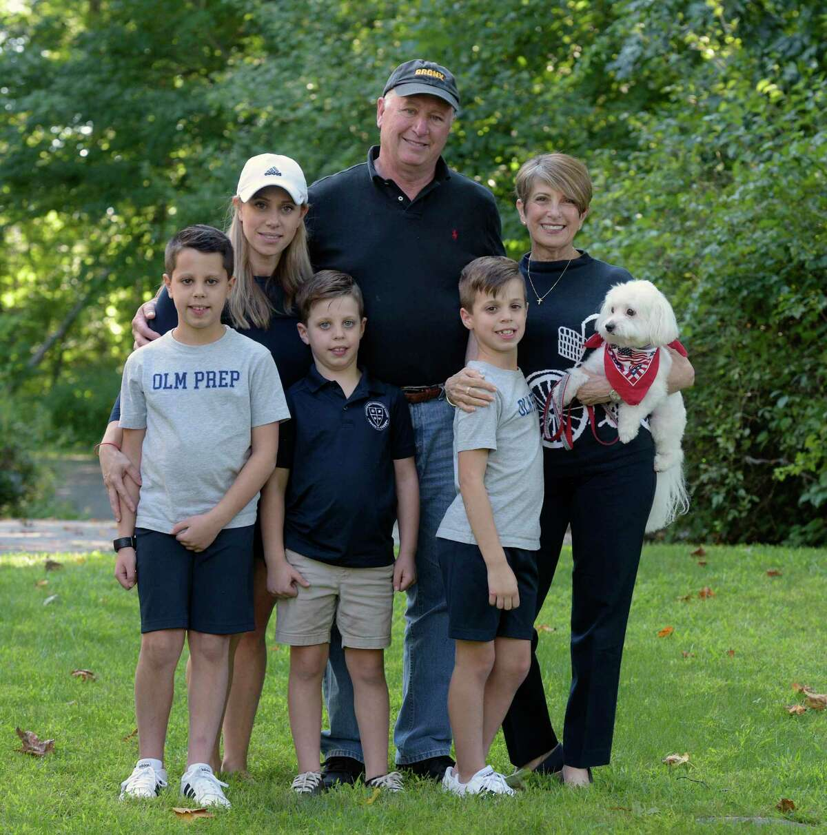 Robert Hofmiller, center, of Guilford, and his family, including wife Rosemary, right, and daughter Jacqueline Ciocca, left, of Madison. Hofmiller lost his sister Judith Hofmiller, of Brookfield, in the twin towers on 9/11. With them are his grandsons Luke Ciocca, left, 10, Peter Ciocca, 6, and Jack Ciocca, right, 8.