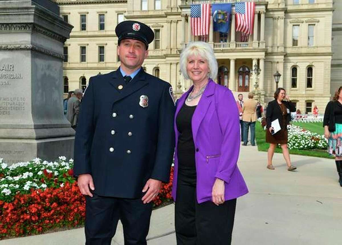 Rep. Annette Glenn is pictured with Midland firefighter Justin Fox at the state Capitol in Lansing. (Photo provided)