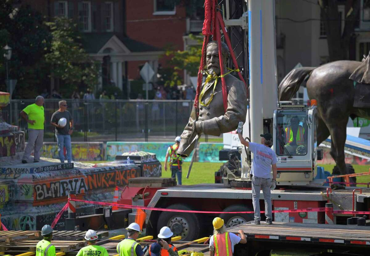 Crews remove the Robert E. Lee statue's torso from his horse during the dismantling of the statue on Monument Avenue in Richmond on Sept. 8, 2021.