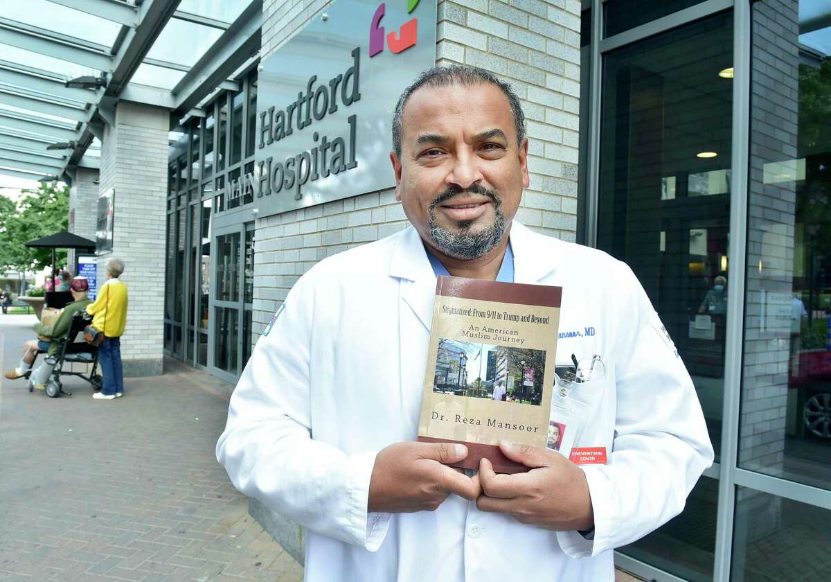 """Dr. Reza Mansoor, a cardiologist at Hartford Hospital, on Sept. 08, 2021, is the board president of the Muslim Association of Connecticut. Since 9/11 he has given a number of talks about Islam and to dispel misconceptions. He has authored the book """"Stigmatized: from 9/11 to Trump and Beyond,""""about his experience as a Muslim after 9/11."""