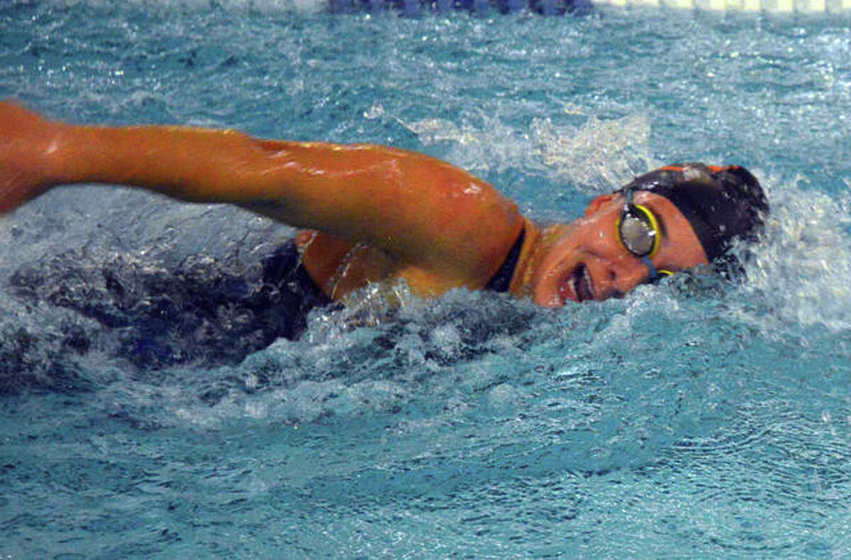 Edwardsville swimmer Ally Janson competes last season during a dual meet inside the Chuck Fruit Aquatic Center.