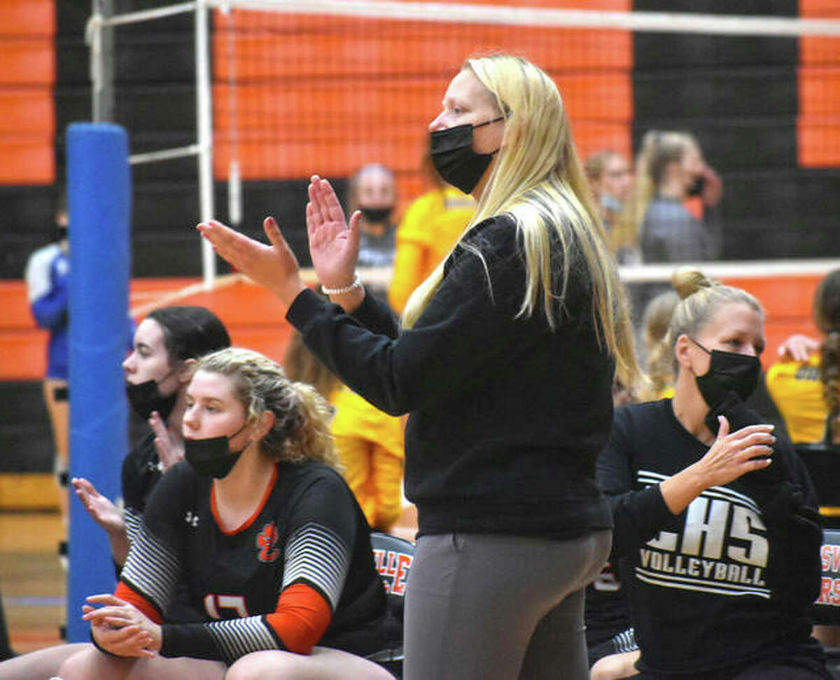 Edwardsville girls volleyball coach Heather Ohlau encourages her team during a semifinal match against Mater Dei in the Tiger Classic on Saturday at Edwardsville High School.