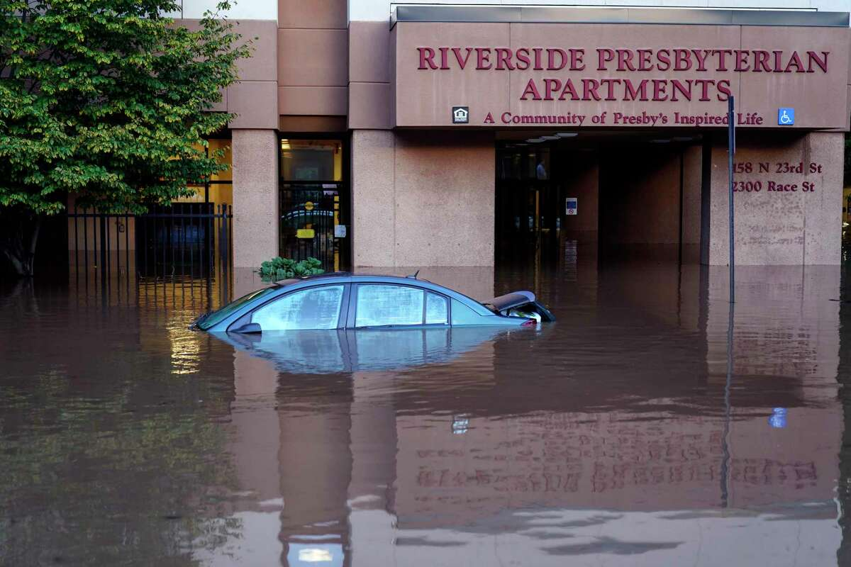 A vehicle is under water during flooding in Philadelphia Sept. 2, 2021, in the aftermath of downpours and high winds from the remnants of Hurricane Ida that hit the area.
