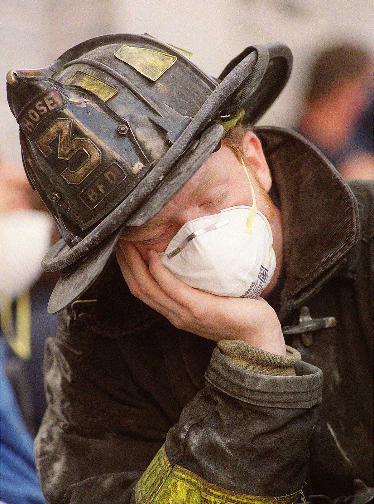 Bill Fennelly, a volunteer firefighter from Baldwin, New York, pauses for a moment at the World Trade Center collapse in New York City, Thursday morning, Sept. 13, 2001. (AP Photo/Stephen Chernin)