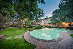 The huge backyard has a pool and plenty of green space.