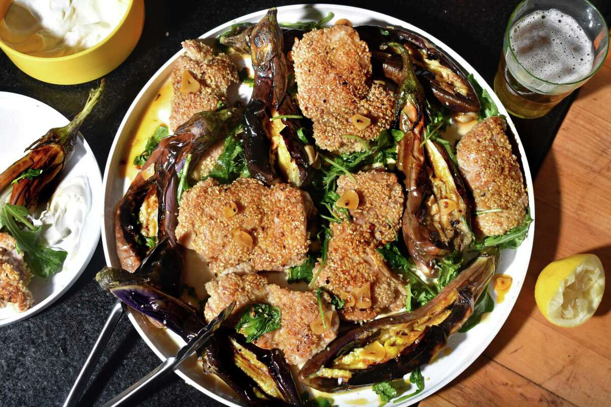 A robust honey sauce punches up a dish of pan-fried whole Japanese eggplant and crispy sesame-crusted chicken.