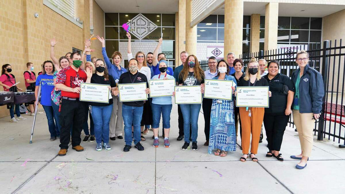 A group of Clear Creek ISD educators show off checks from Clear Creek Education Foundation grants. The foundation is planning a series of fundraisers this school year, starting with Dine Out to Donate on the calendar for Oct. 4.