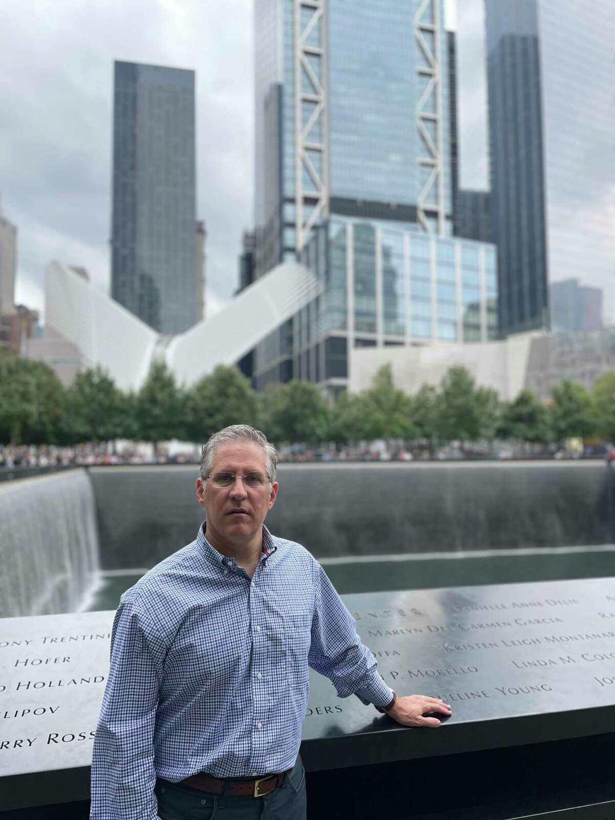 Darien resident Brian Moss stands beside the reflecting pools that commemorate where the World Trade Center's twin towers stood in lower Manhattan, during a visit to the site on Sept. 5, 2021. Moss was working in nearby offices at 44 Wall St., on Sept. 11, 2001 and saw the South Tower collapse.