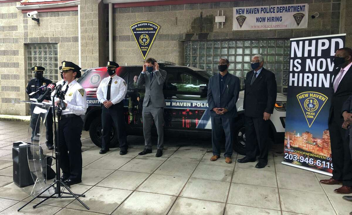 Officials urged residents to apply to become New Haven police officers Thursday, noting that the department has dozens of open positions. Here, Interim Chief Renee Dominguez speaks.