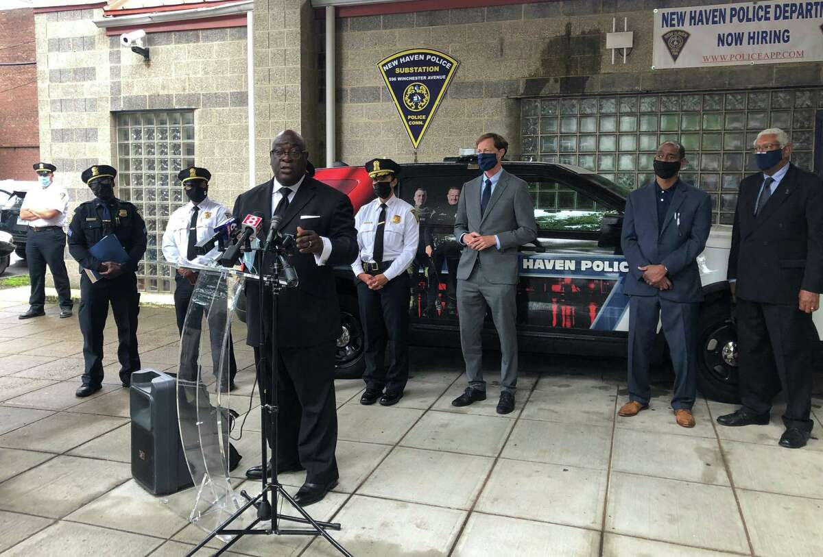 Officials urged residents to apply to become New Haven police officers Thursday, noting that the department has dozens of open positions. Here, the Rev. Boise Kimber speaks.